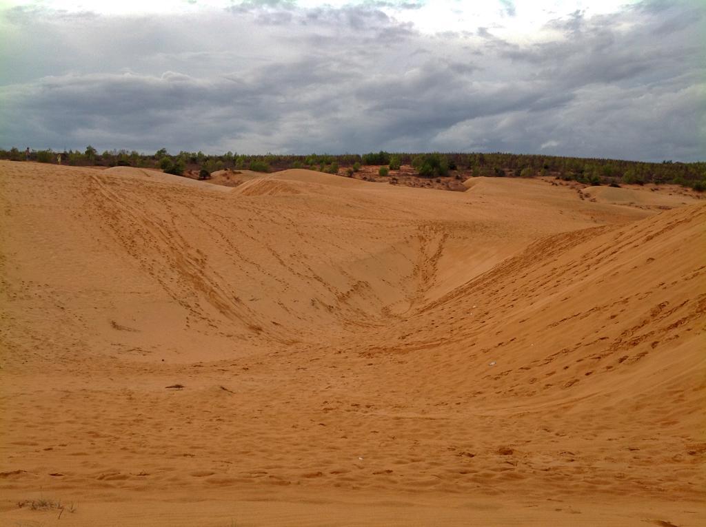 Is it worth visiting Mui Ne - Red Sand Dunes Mui Ne with a dark cloudy sky