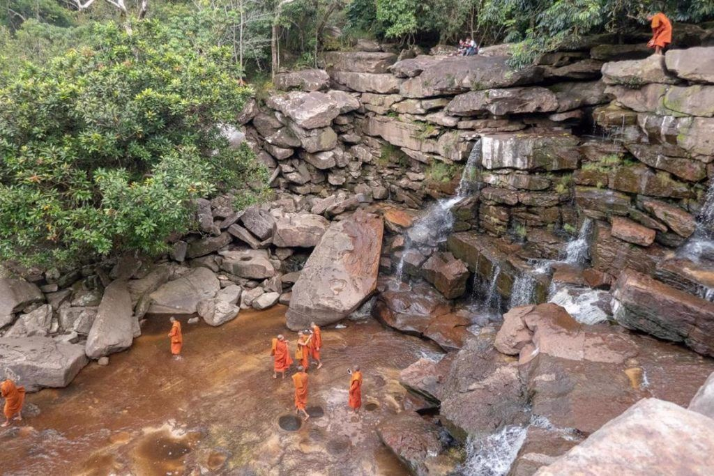 Bokor National Park Cambodia Monks taking selfies at the bottom of Povokil Waterfall