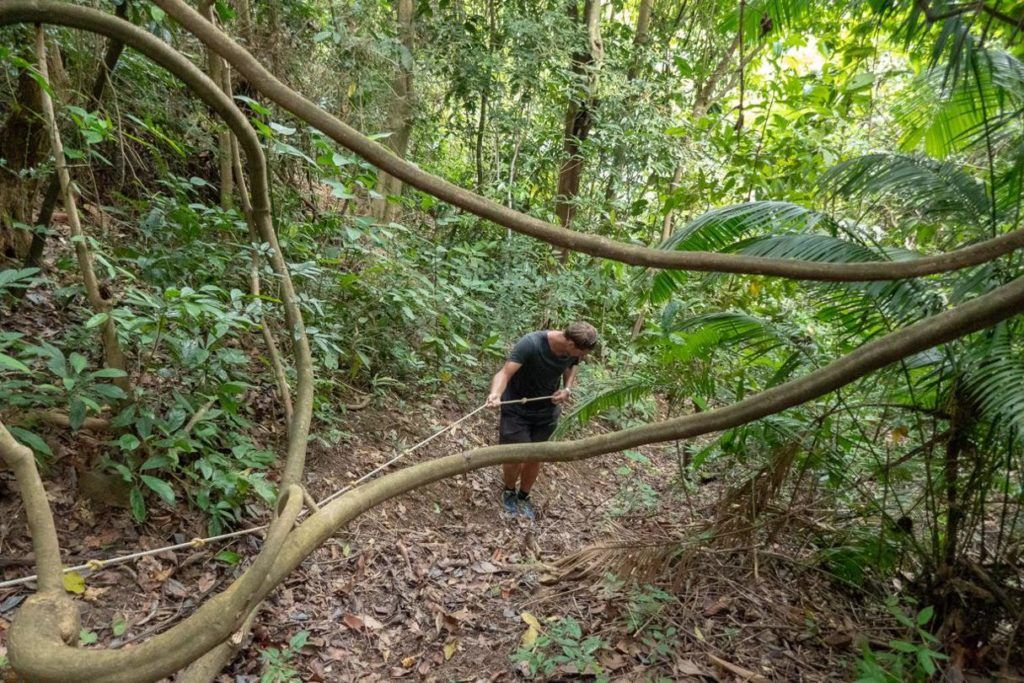 Kep National Park Cambodia Hiking Trails Ben descending a steep section of the hiking trail
