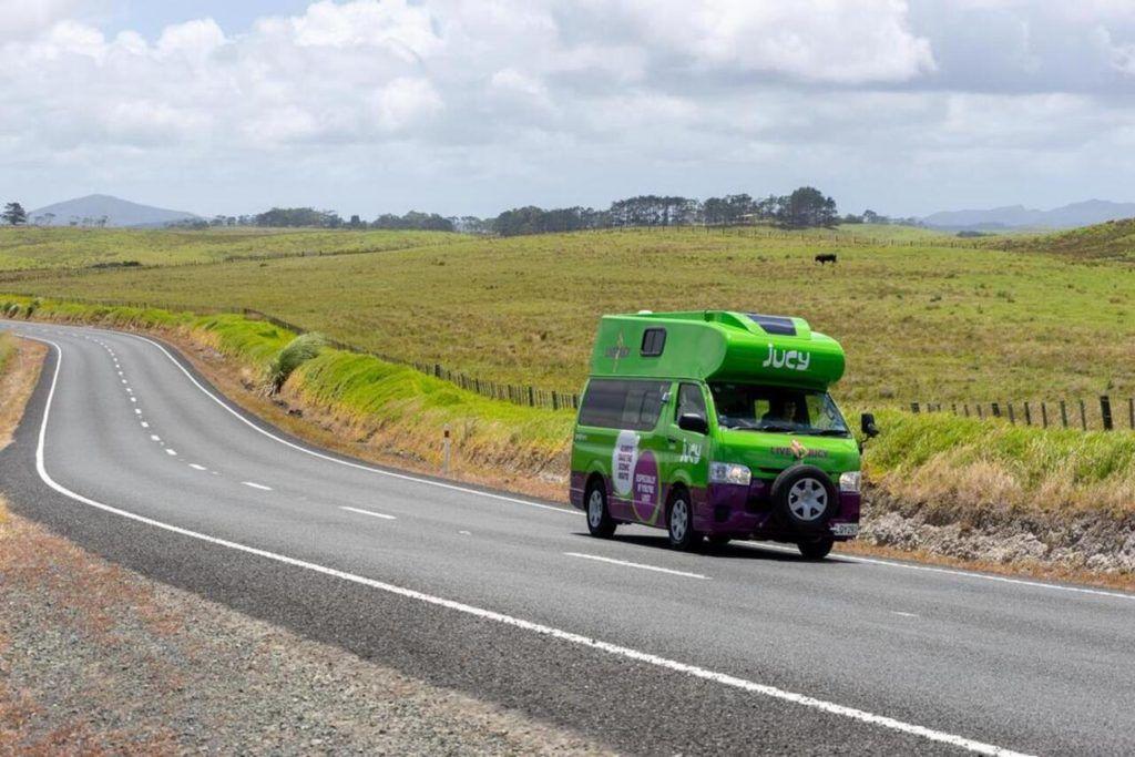 Juicy campervan in New Zealand country side