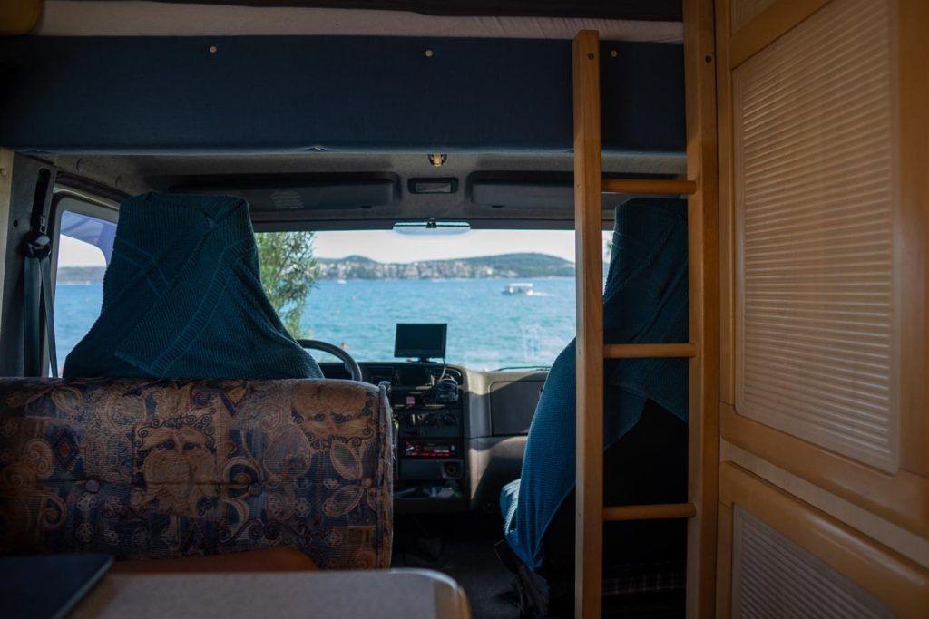 Europe by campervan - Inside a campervan looking at ocean